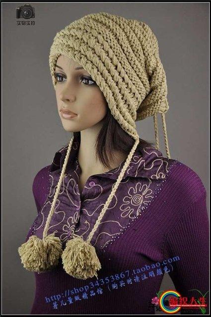 Молодежная шапочка с завязками-помпонами (спицы). как вязать.